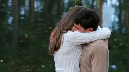 tenderness : Two young people embracing in park at water