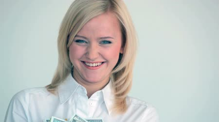 zengin : Happy blonde holding heap of dollar bills in her hands