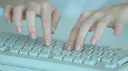 spojení : Secretary hands pressing keys of computer keyboard