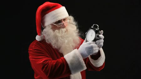 natal : Santa pointing at clock as if reminding Stock Footage