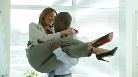 boss : Businessman carrying his colleague in his arms and spinning around Stock Footage