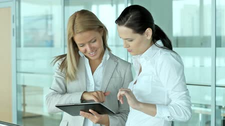 таблетка : Business ladies using a tablet pc to find necessary information on some business matters