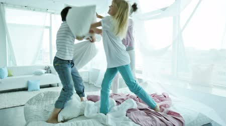 poduszka : Children staying at their place and fighting pillows cheerfully Wideo