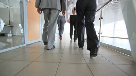 walking back : Business team marching along the corridors of the office building  Stock Footage