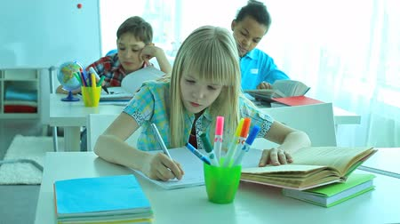 домашнее задание : Three cute school children busy doing tasks