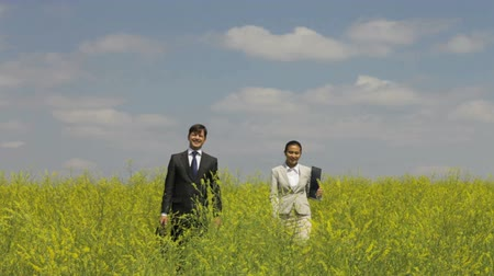 collaborator : Business team dressed elegantly spending time in the rural area  Stock Footage
