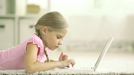nevinný : Little lady being busy typing on her laptop