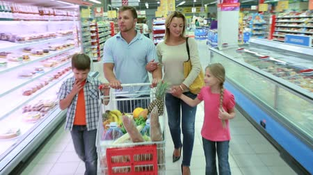покупка товаров : Young affectionate family bonding in a shopping mall