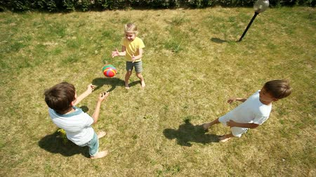 teen action : The above-view of cheerful children tossing the ball