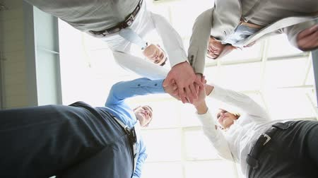дружба : Conceptual video of business team putting their hands together as a sign of integrity and cooperation