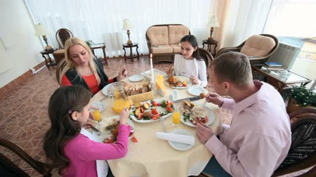 vacsora : Family of four celebrating having a festive dinner together