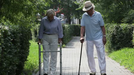 инвалидность : Disabled patients of a nursing-home taking a walk together