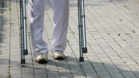 kavramsal : Close-up of a retired man using a walker outdoors