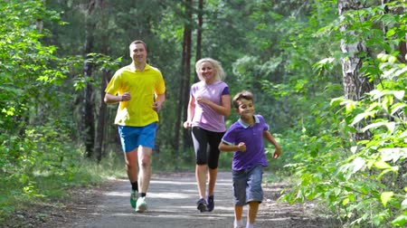 klipek : Competitive lad outrunning his parents on a family jog