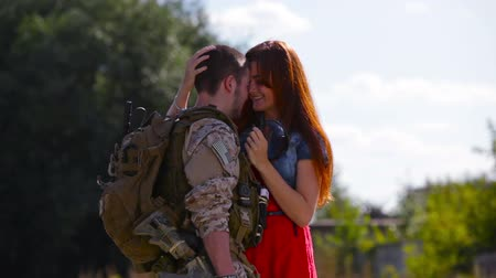 soldados : Young man coming home from army welcomed by his pretty girlfriend Stock Footage