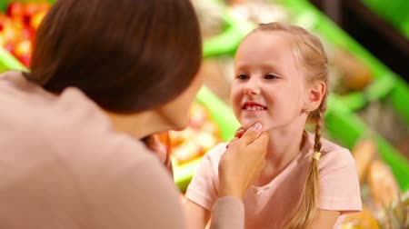 mother love : Close-up of a tender mom talking to her cute daughter Stock Footage