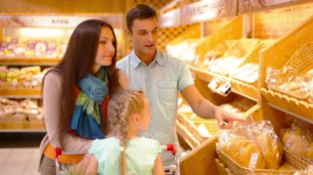 bakery : Modern family choosing fresh bakery products in the hypermarket Stock Footage