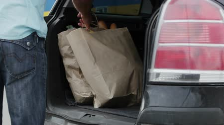 transportar : Purchases being packed in the car trunk after shopping Stock Footage