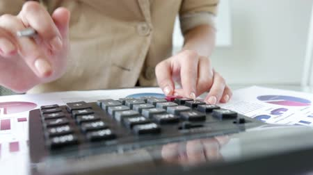 statistic : Close-up of businesswoman calculating company profit