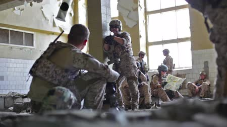 repousante : Soldiers having a rest in an abandoned building