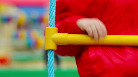 preschool : Close-up of an energetic kid climbing up the rope ladder