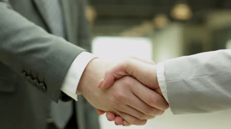 рукопожатие : Handshake of business partners Стоковые видеозаписи