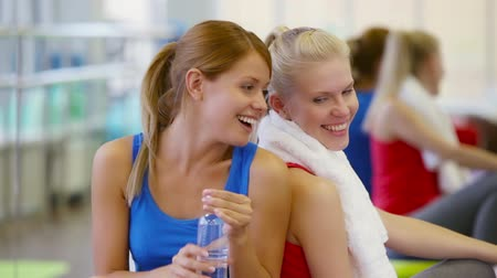 paylaşımı : Girls being tired after workout sharing water to avoid dehydration