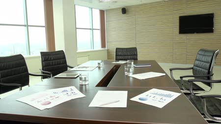 интерьер : The interior view of a contemporary business office with financial documents lying on the table