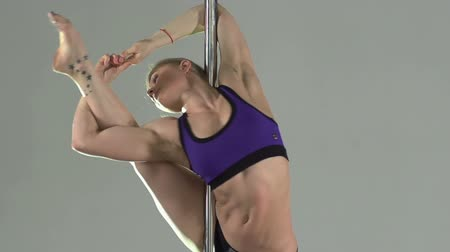 gymnasta : Sensual pole dancer keeping fit and enhancing her flexibility