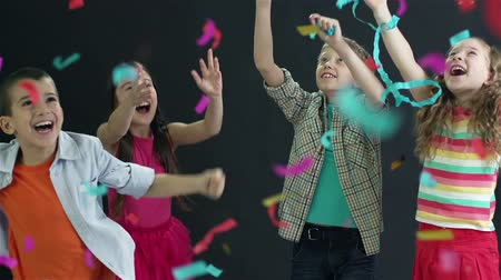 jump : Slow-motion of cute kids jumping in excitement at celebration
