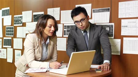 financial : Experienced associates carrying out a financial expertise computing on laptop