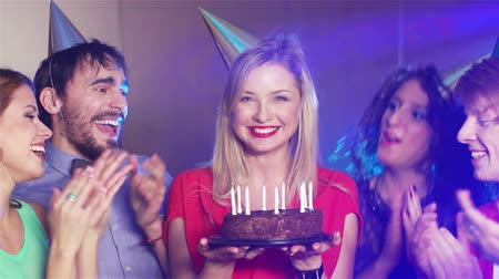 üfleme : Cheerful girl celebrating her birthday together with her friends Stok Video