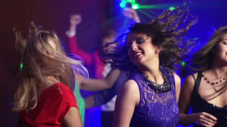 discotheque : Slow-motion of carefree girls dancing in the nightclub