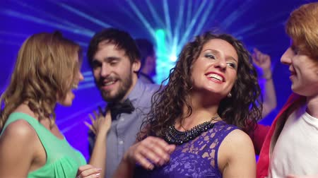 a party : Slowing down video of young people hanging out together  Stock Footage