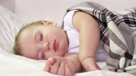 napping : Peaceful child being in bed sleeping comfortably  Stock Footage