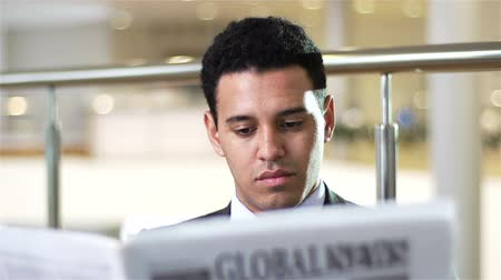 financial : Close-up of a white-collar worker reading the latest news
