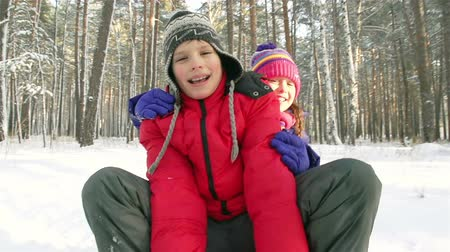 dişlek : Close-up of funny preteen children enjoying a sled ride Stok Video