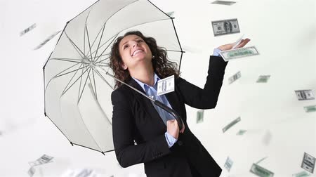 sampiyonlar : Happy girl in formalwear hiding from a pouring money rain under umbrella