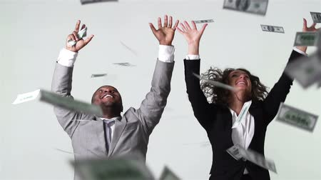 vzrušený : Conceptual video of business people catching falling dollar banknotes