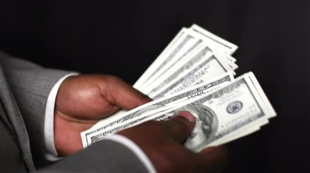 sayma : Close-up of an African-American businessman counting hundred dollar bills