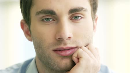 serene : Calm man looking at camera Stock Footage