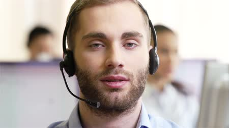 telecoms : Young guy wearing headset looking straight into camera