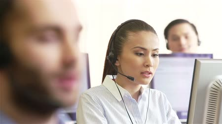 telecoms : Handsome telecom agent and his attractive female colleague at helpdesk