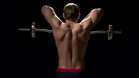 fisiculturismo : Bodybuilder with his back to the camera doing upright row