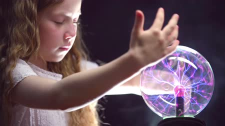 czarodziej : Static close-up of girl rotating magic ball rays  Wideo