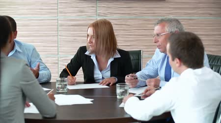 projects : Pan of business people brainstorming at round table Stock Footage