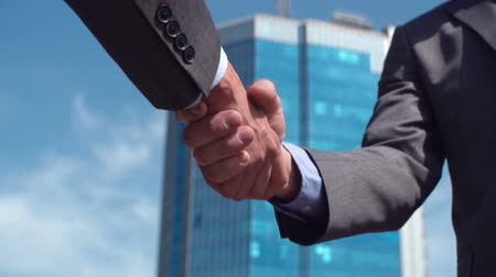 képviselő : Conceptual video of business people shaking hands in agreement