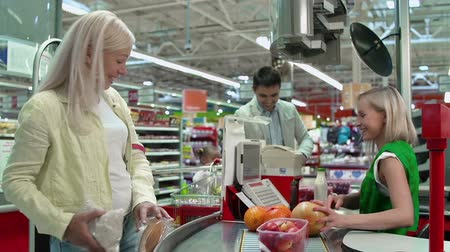 grocery : Pedestal down of family at cash-till buying food Stock Footage