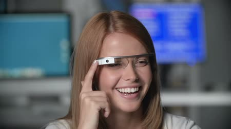voz : Girl having online chat with friend via eyewear gadget, laughing and smiling joyfully all the time