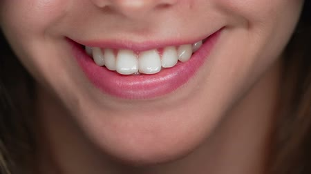 ağız : Extreme close up of female mouth smiling Stok Video